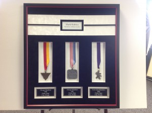 Marathon Medals framed in a shadowbox with 4 engraved plates