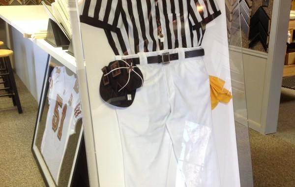 Referee uniform framed in plexiglass box