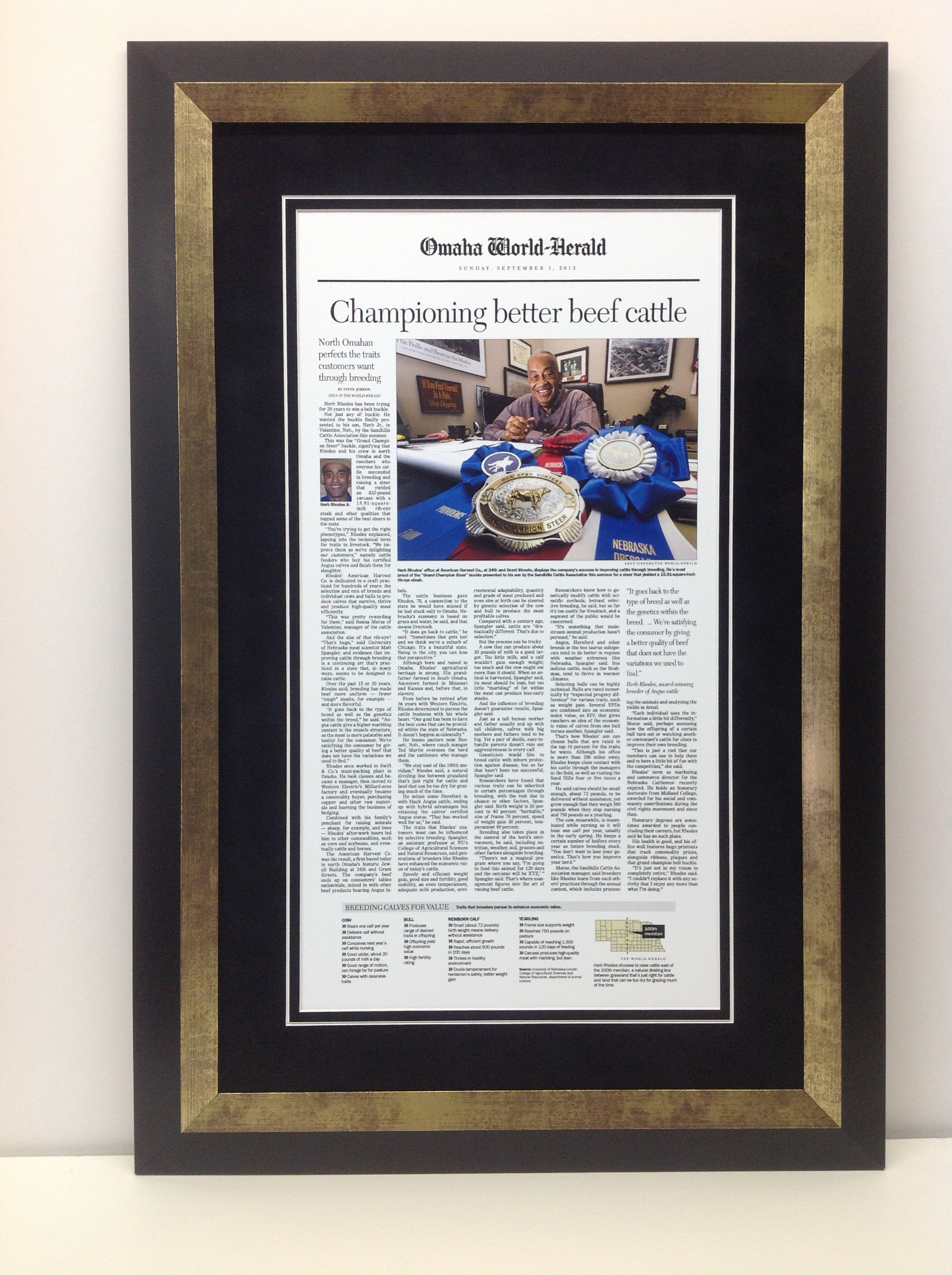 newspaper article from the omaha world herald framed with black suede mat and blackgold frame