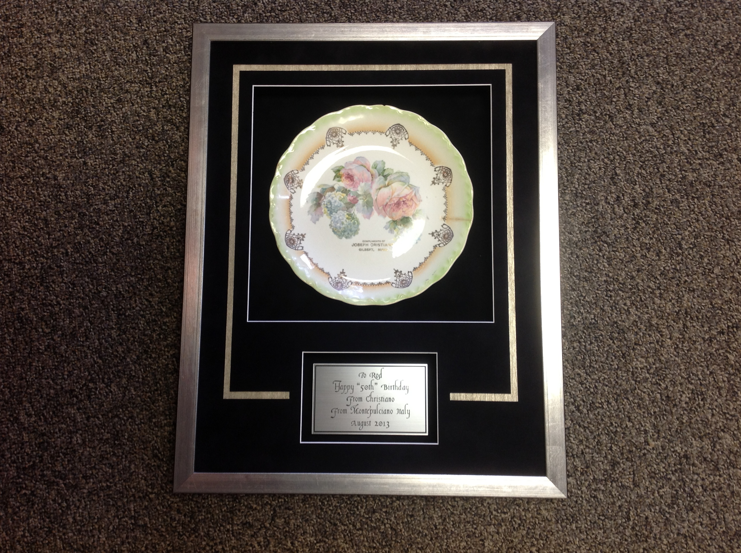 yes we frame plates heres one with an engraved description added - Engraved Frame