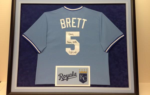 George Brett jersey framed with Kansas City Royals logo